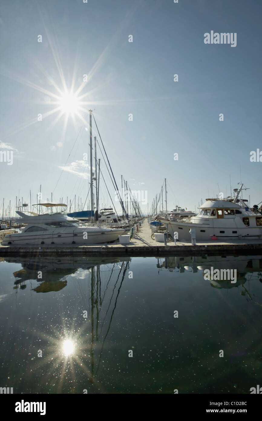 Marina Boat Dock with Clear Blue Sky and Water Reflection 4 - Stock Image