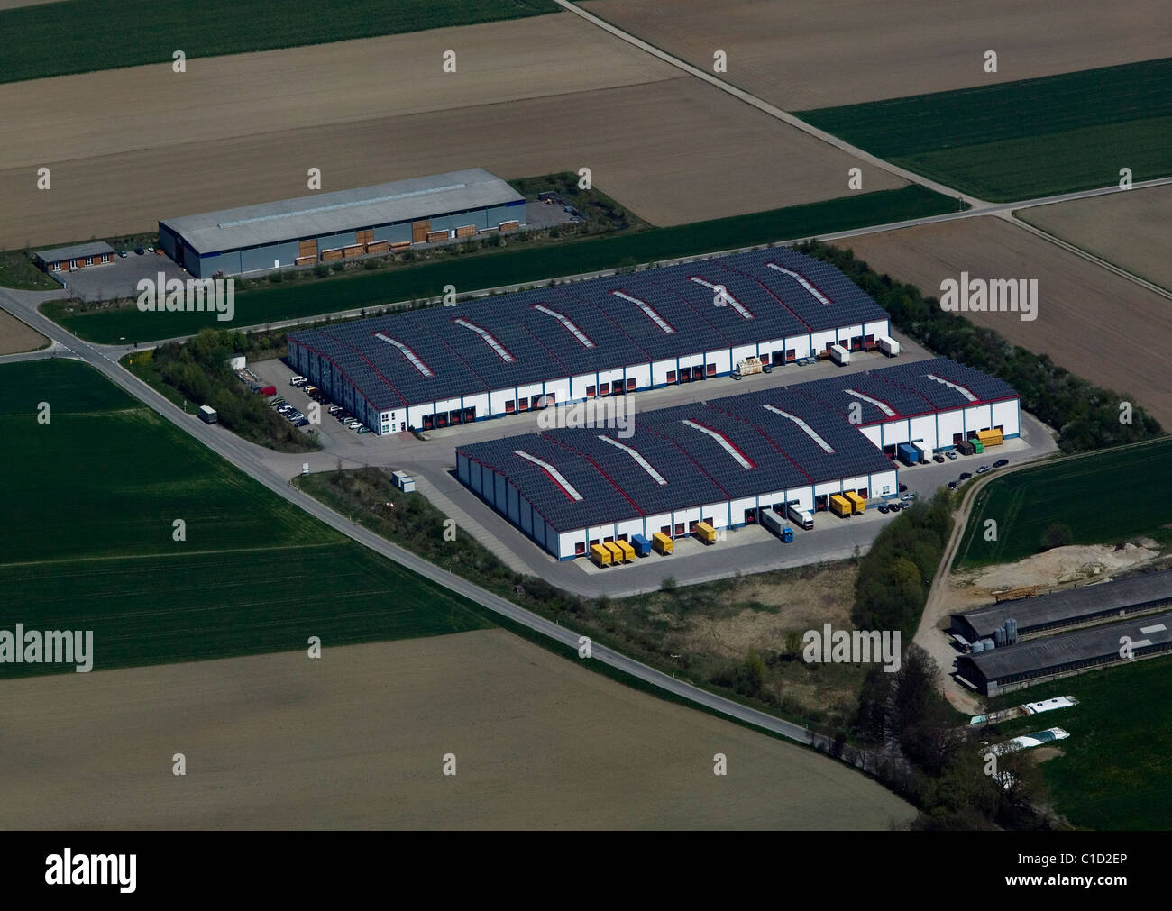 aerial view above warehouse roof covered with solar panels Bavaria Germany - Stock Image