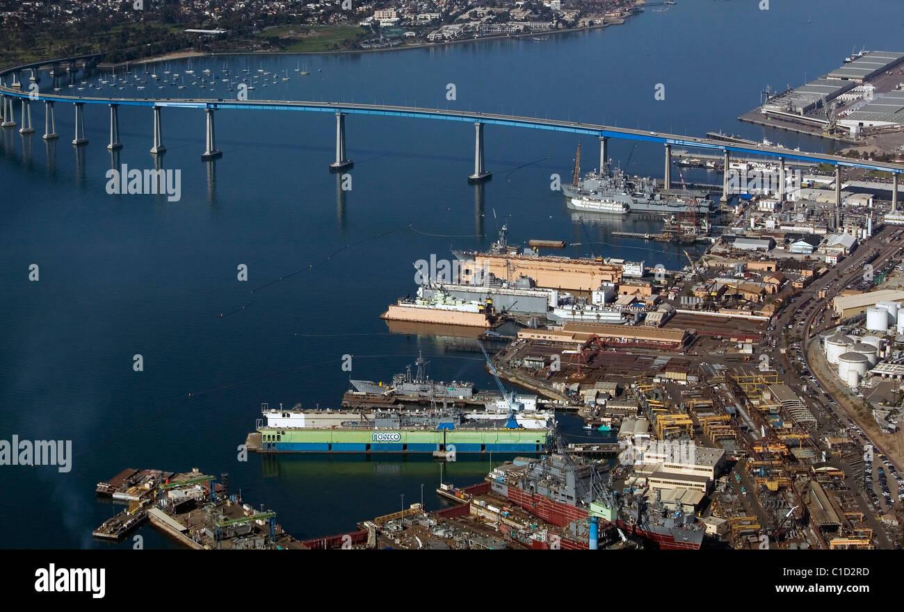 aerial view above General Dynamics NASSCO ship construction yard Port of San Diego and Coronado Bridge California Stock Photo