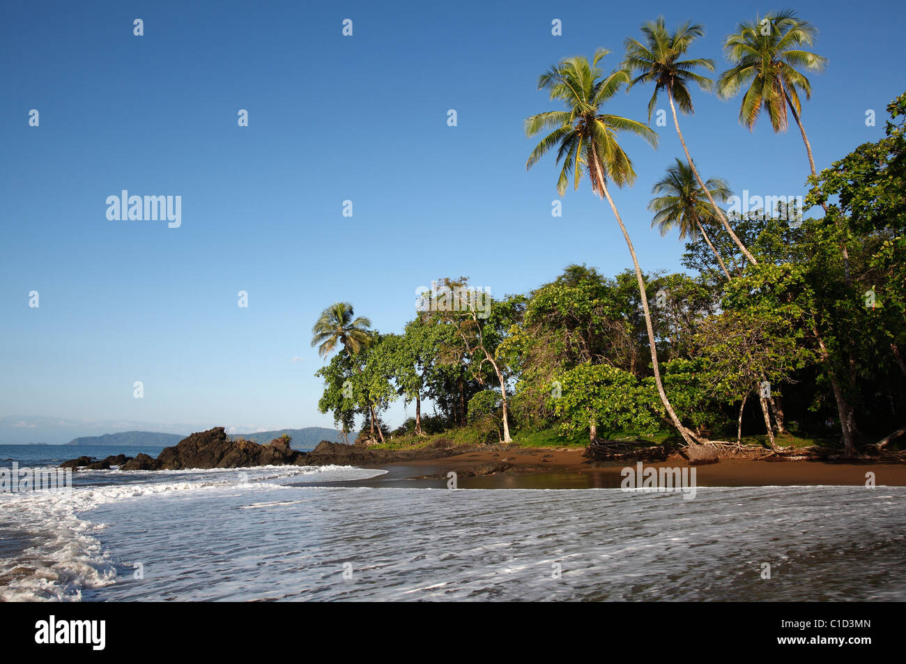 A tropical beach near Drake Bay along the trail to Corcovado National Park on the Osa Peninsula, Costa Rica - Stock Image