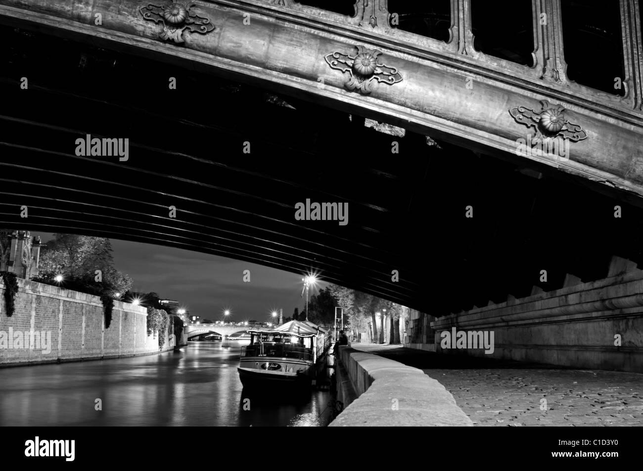 Pont au Double bridge in Paris at night - Stock Image