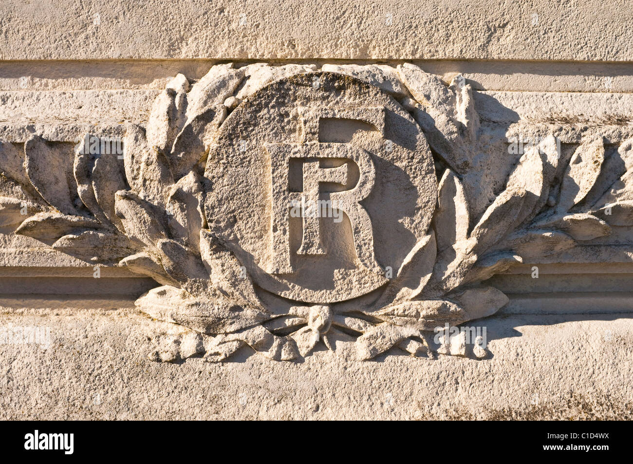 RF / Republique Francaise stone carving on war memorial - France. - Stock Image