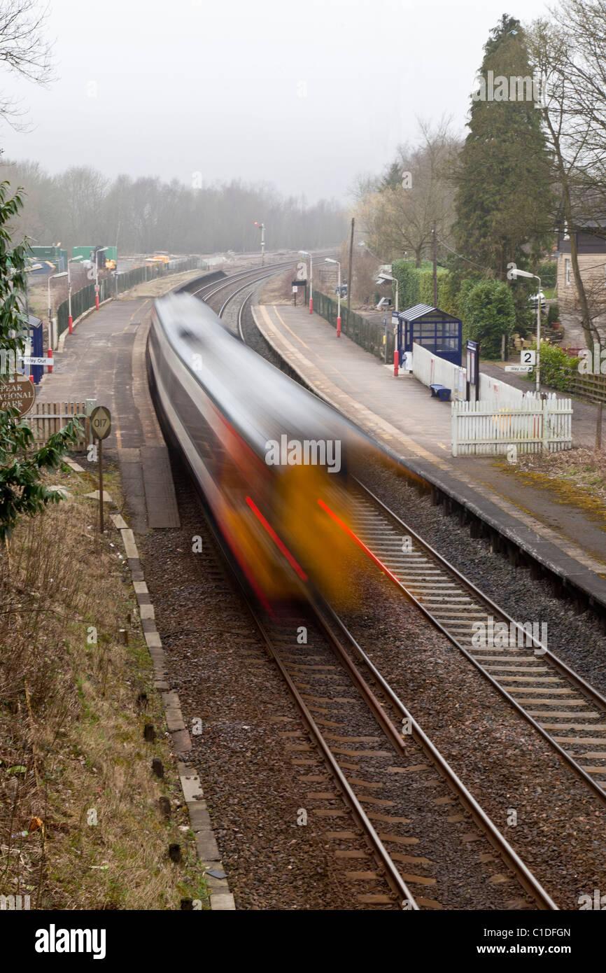 First TransPennine train passing through Grindleford Railway Station, Derbyshire - Stock Image