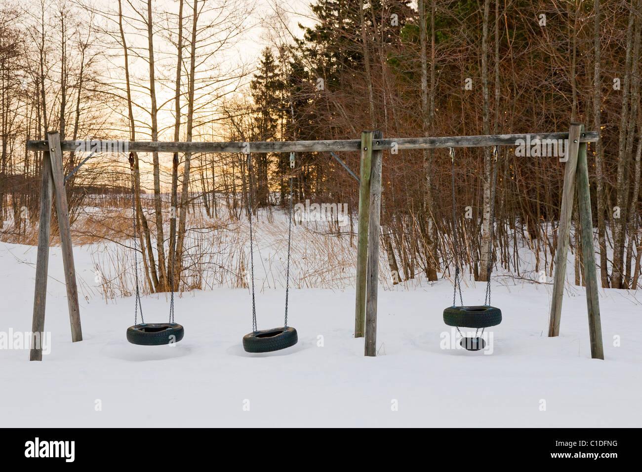 Swings in winter. - Stock Image