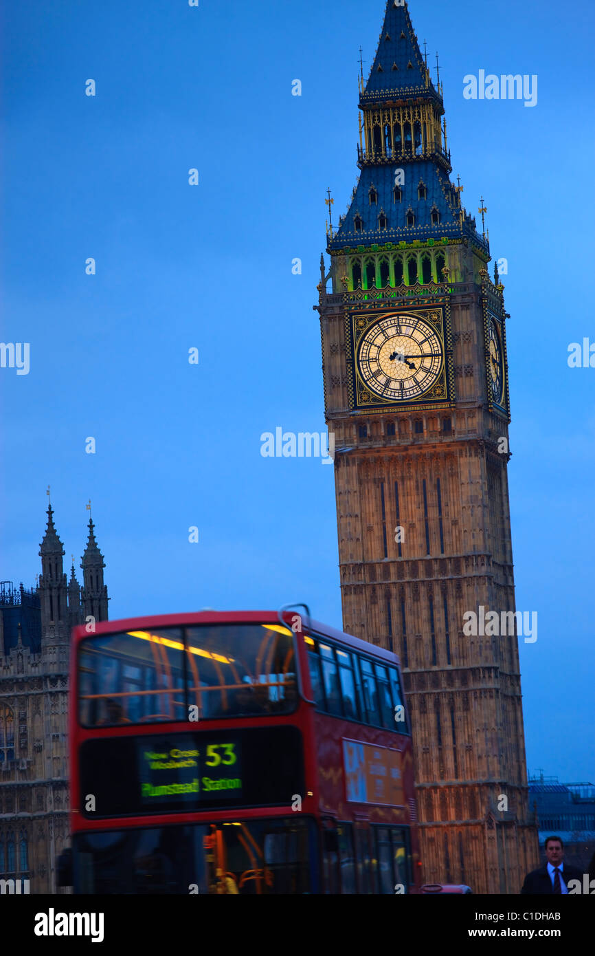 Big Ben and London Red Bus Westminster London England UK in evening light - Stock Image
