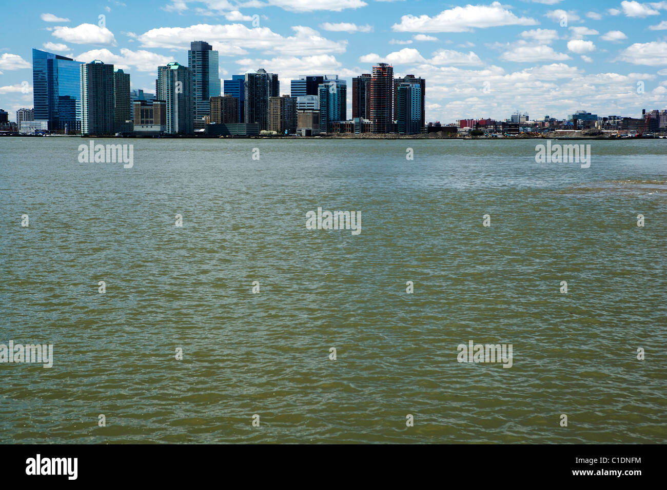 The New York Skyline and the Hudson River in the foreground - Stock Image
