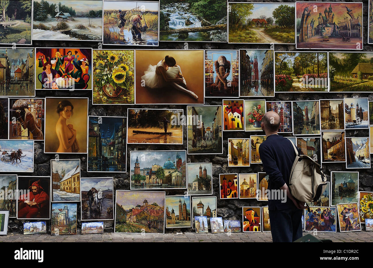 Poland Lesser Poland region Krakow old town (Stare Miasto) paintings of amateurs painters hung on the walls of the - Stock Image