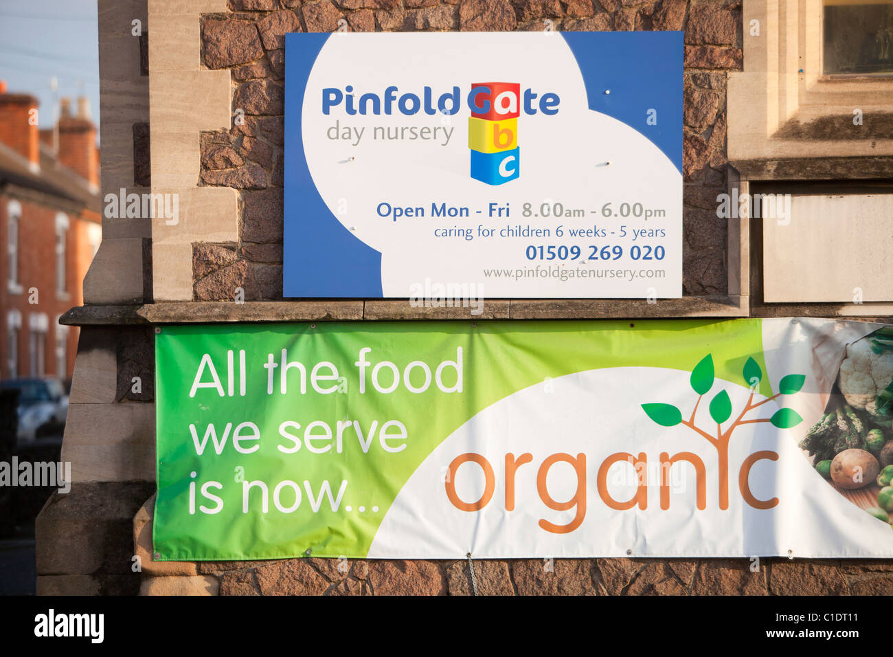 A sign about organic food on a nursery school building in Loughborough, Leicestershire, UK. - Stock Image