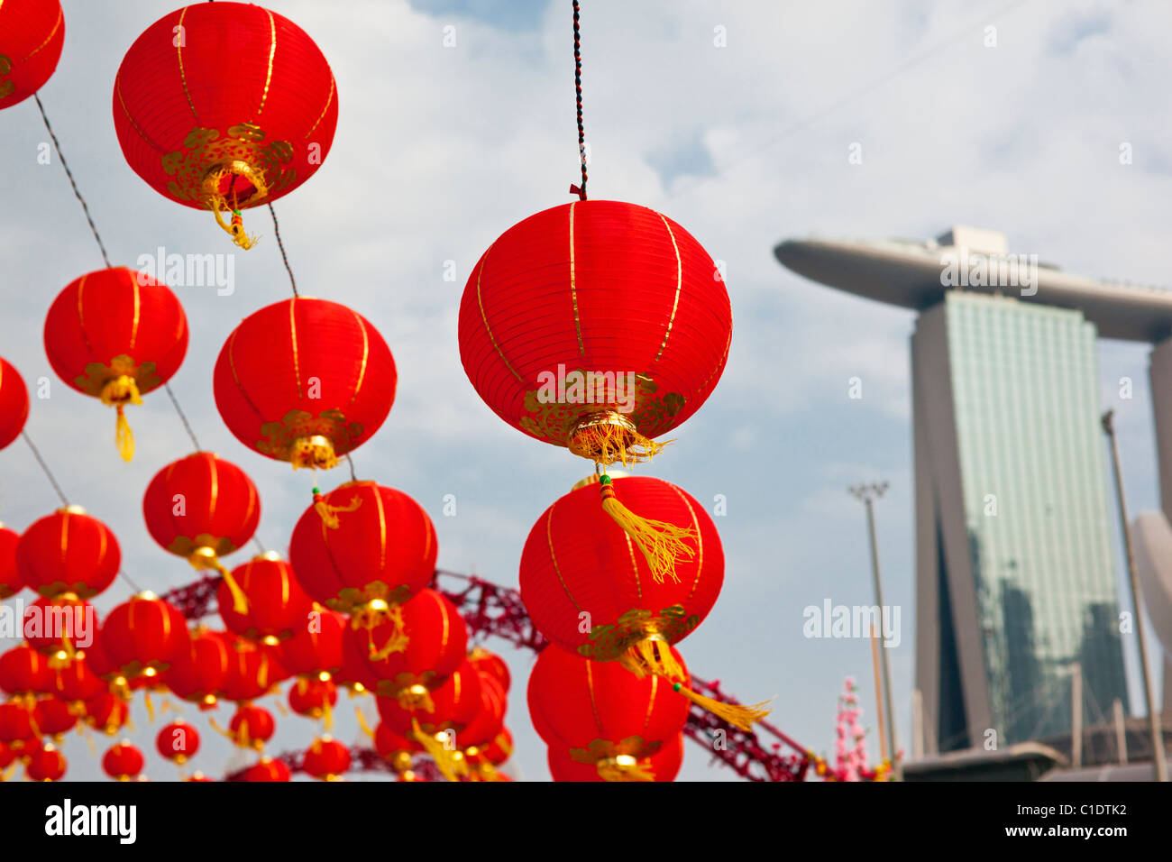 Chinese New Year decorations with the Marina Bay Sands Hotel in background.  Marina Bay, Singapore - Stock Image
