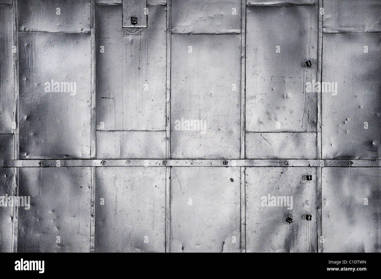 Metal panels on industrial door or wall - Stock Image