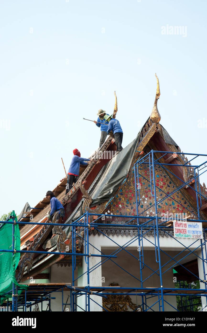 Workers Repairing Temple Roof at Wat Pho Bangkok Stock Photo