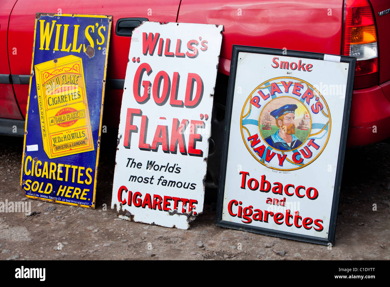 Old cigarette advertising signs. - Stock Image