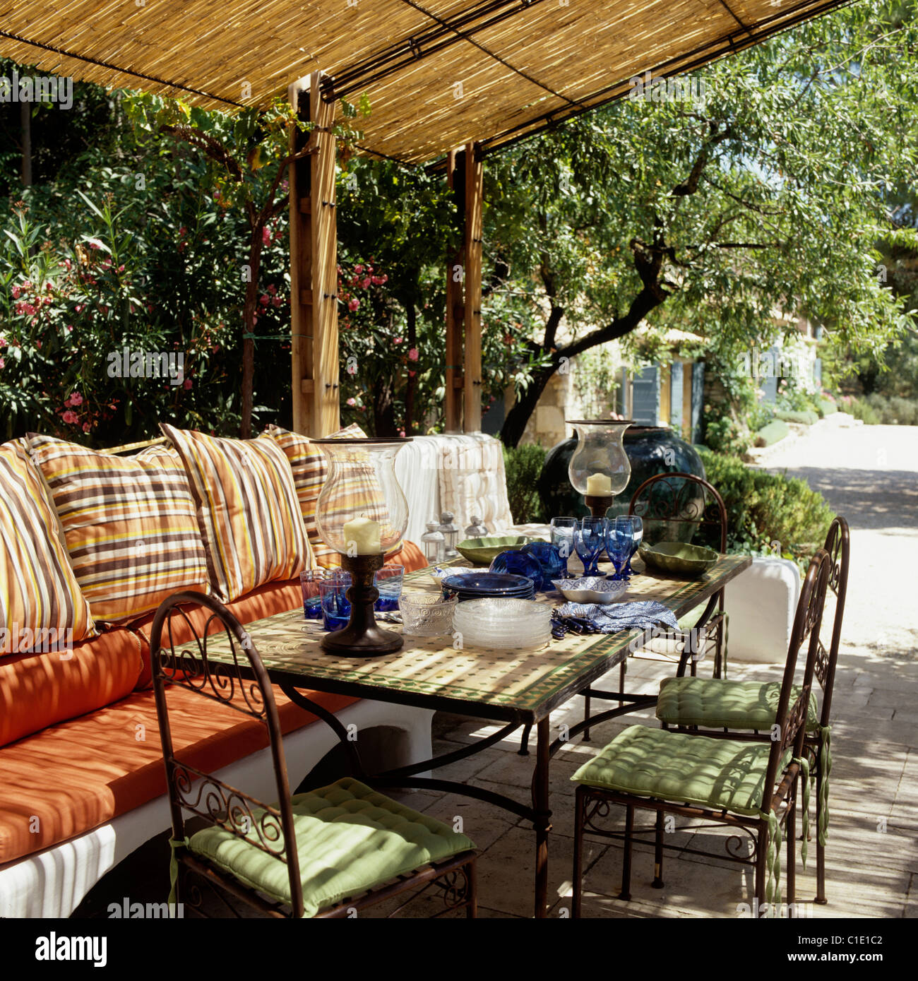 Outdoor furniture under a bamboo awning on terrace of ...