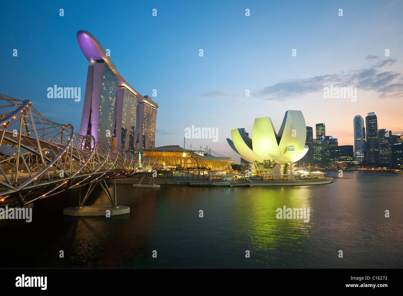 The Helix Bridge and Marina Bay Sands Singapore.  Marina Bay, Singapore - Stock Image