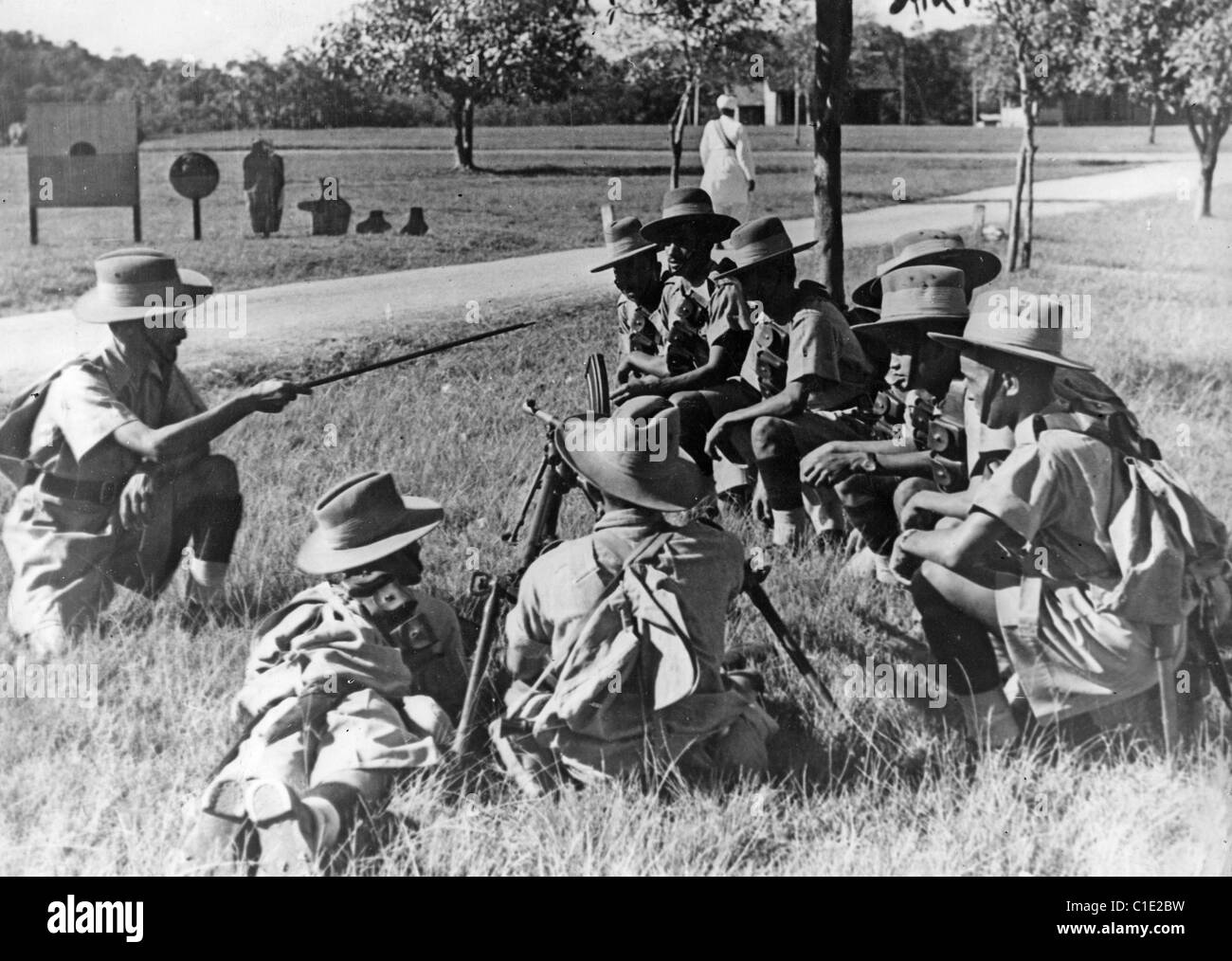 BURMA CAMPAIGN Burmese troops receiving training from a British officer about 1940 - Stock Image