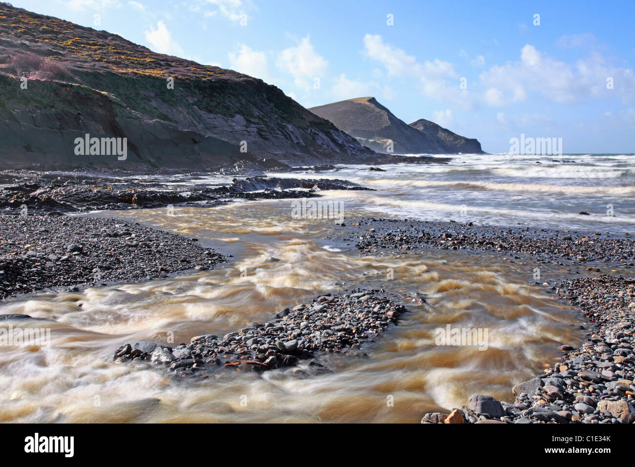 Crackington Haven Beach in North Cornwall captured from next to the stream - Stock Image