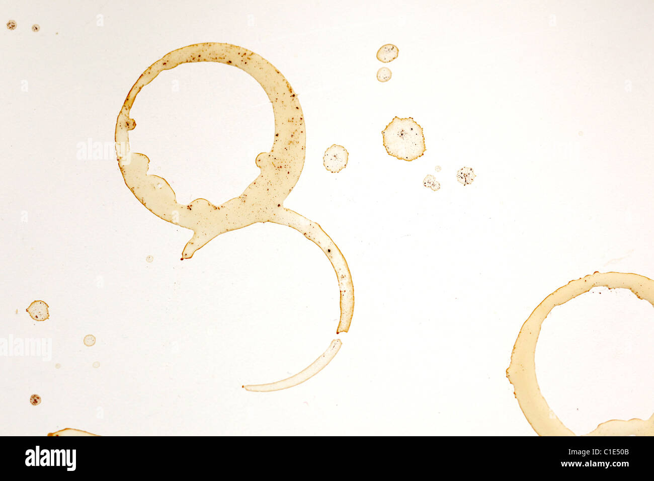 coffee stains and rings on white table - Stock Image
