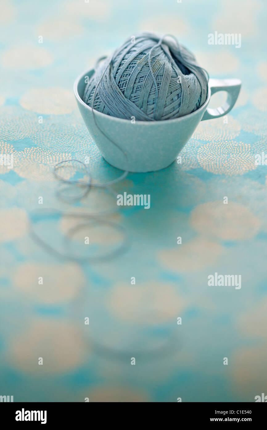 pale blue mel mac vintage coffee cup with ball of string - Stock Image