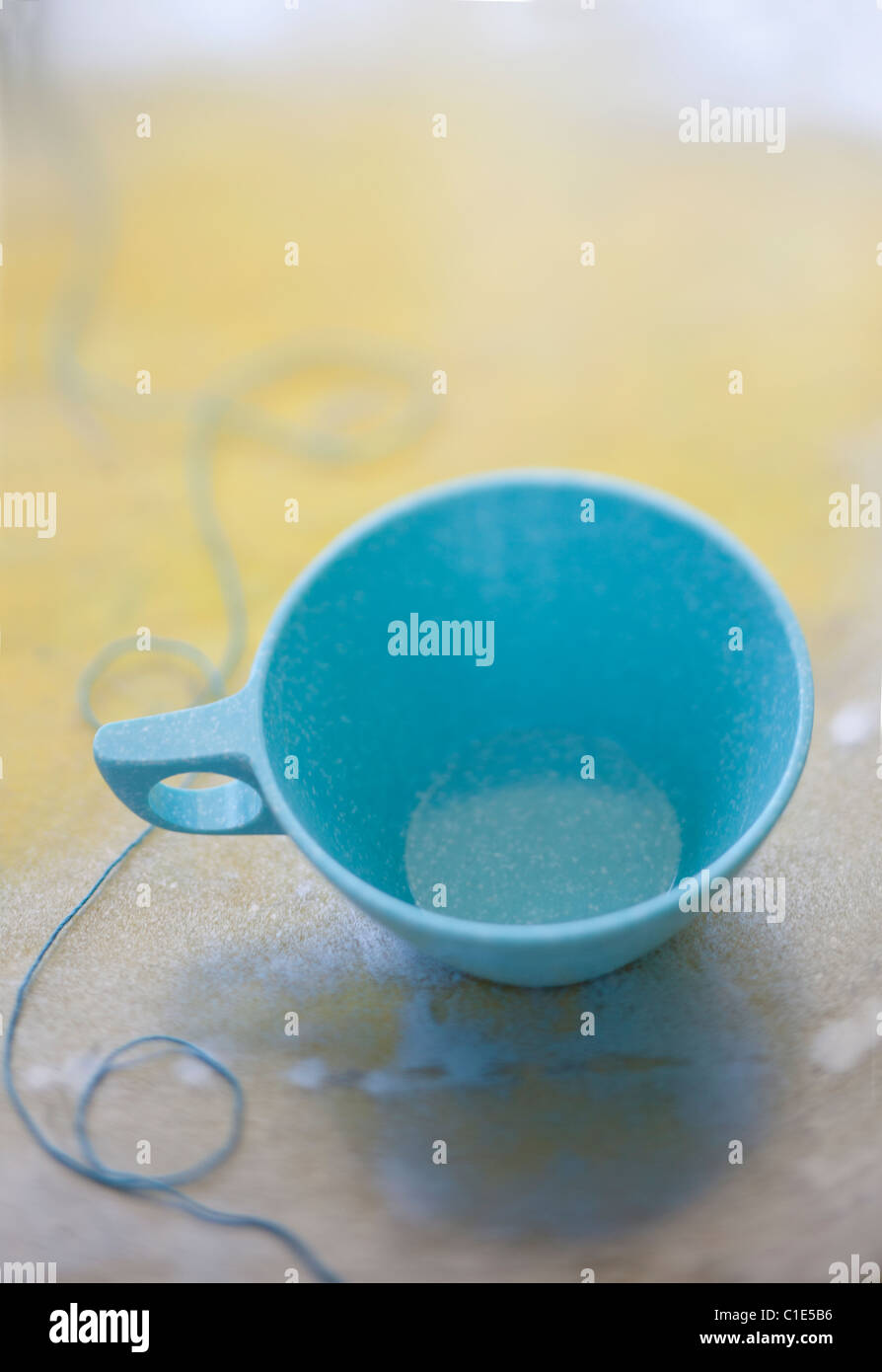 light blue coffee cup with string - Stock Image