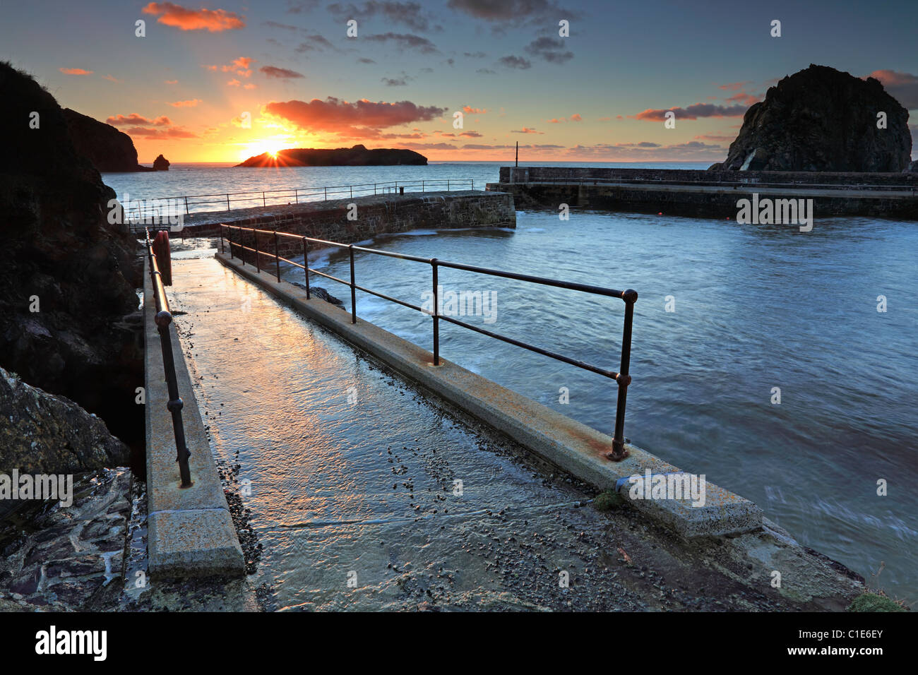 Mullion Harbour in Cornwall captured at sunset - Stock Image