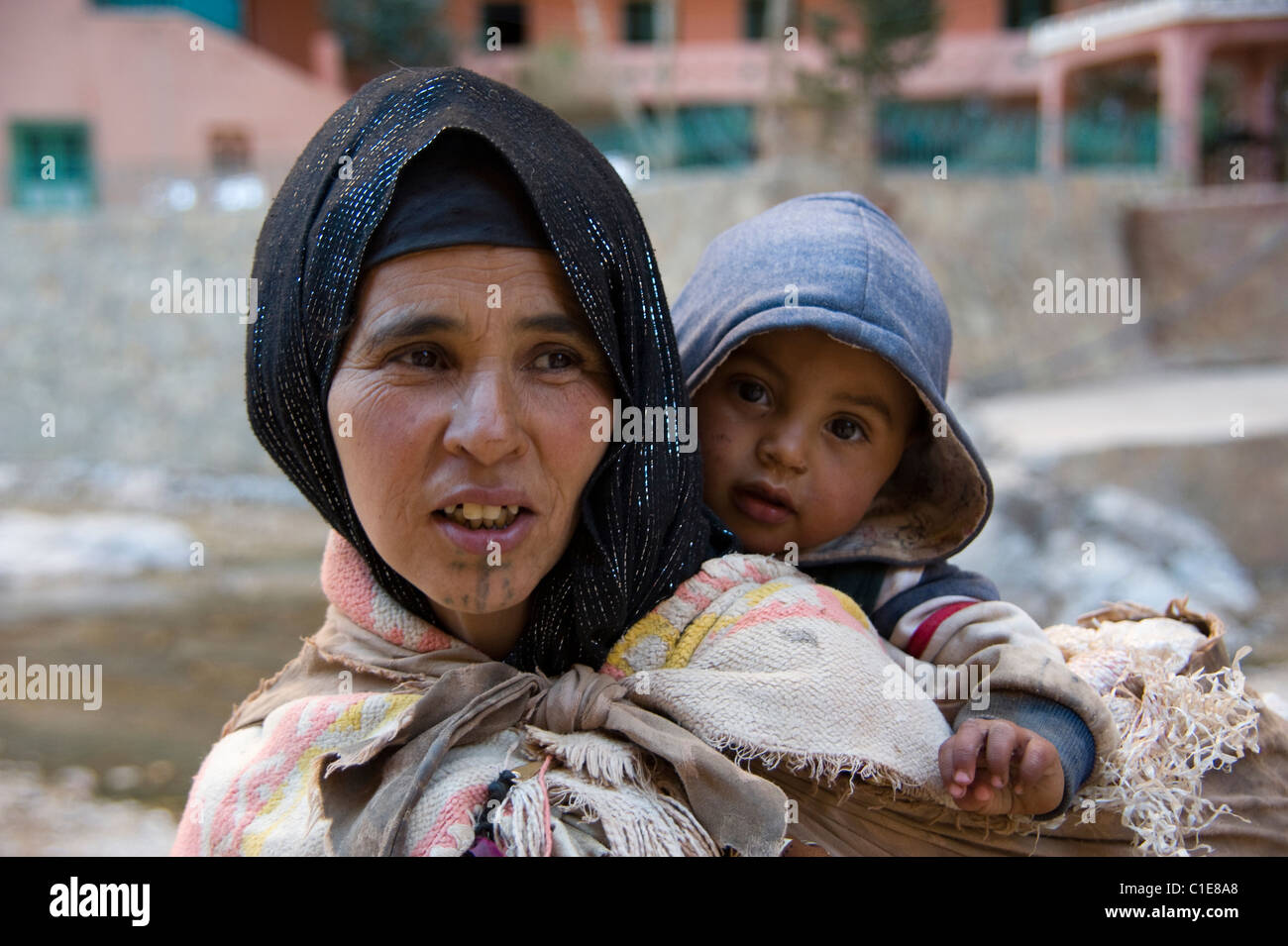 A Berber woman called Eesha and young child from the area of Todra Gorge in Morocco - Stock Image