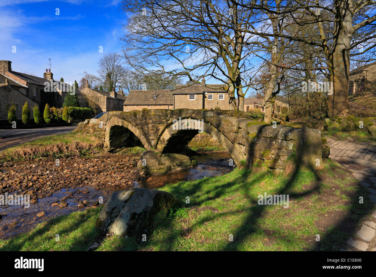 Ancient packhorse bridge at Wycoller Country Park on the Bronte Way, Wycoller, Colne, Pendle, Lancashire, England, - Stock Image