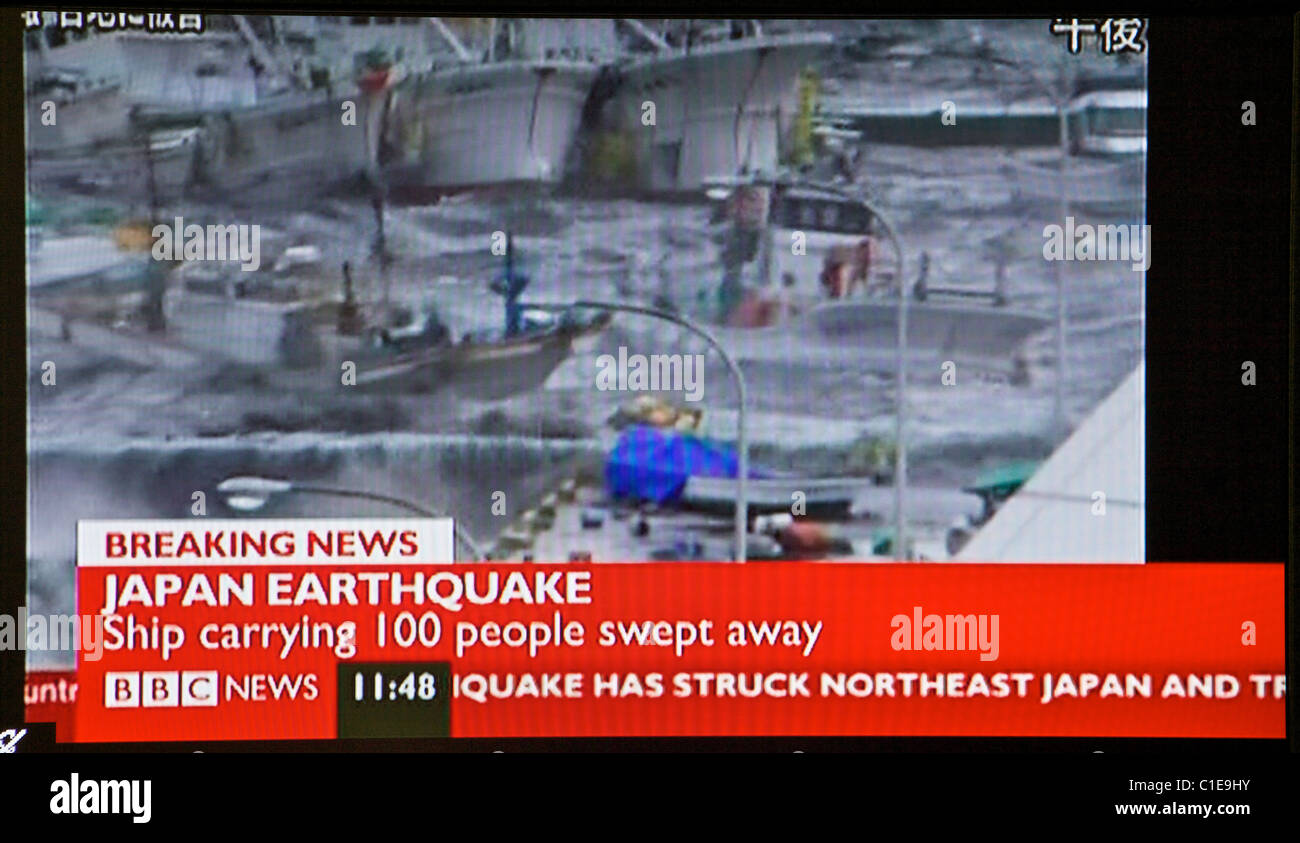 Japan earthquake and tsunami. 11.03.11. Screen grab from United Kingdom television as news emerges from Japan. - Stock Image