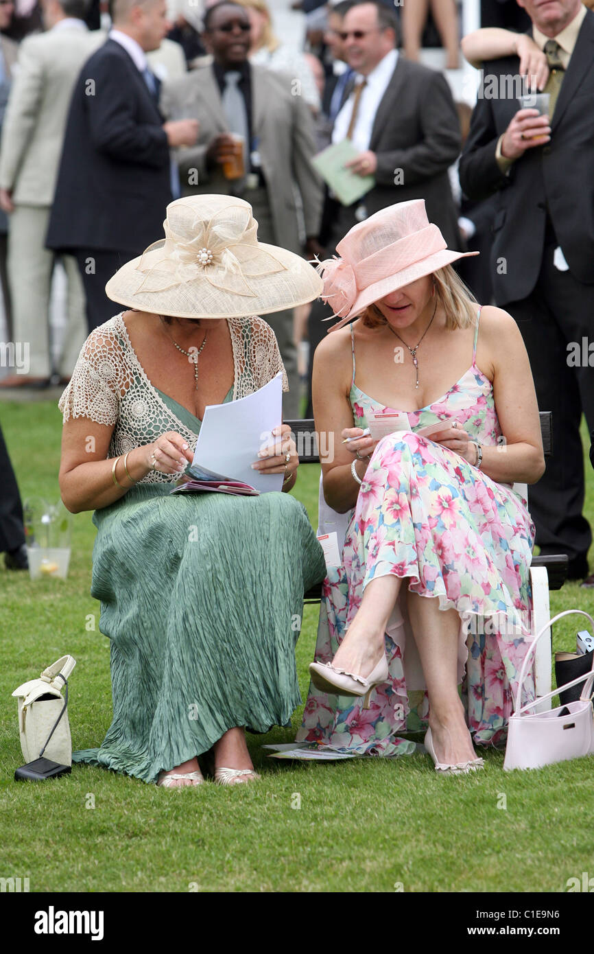 Women in hats at a horse race, Epsom, United Kingdom Stock Photo