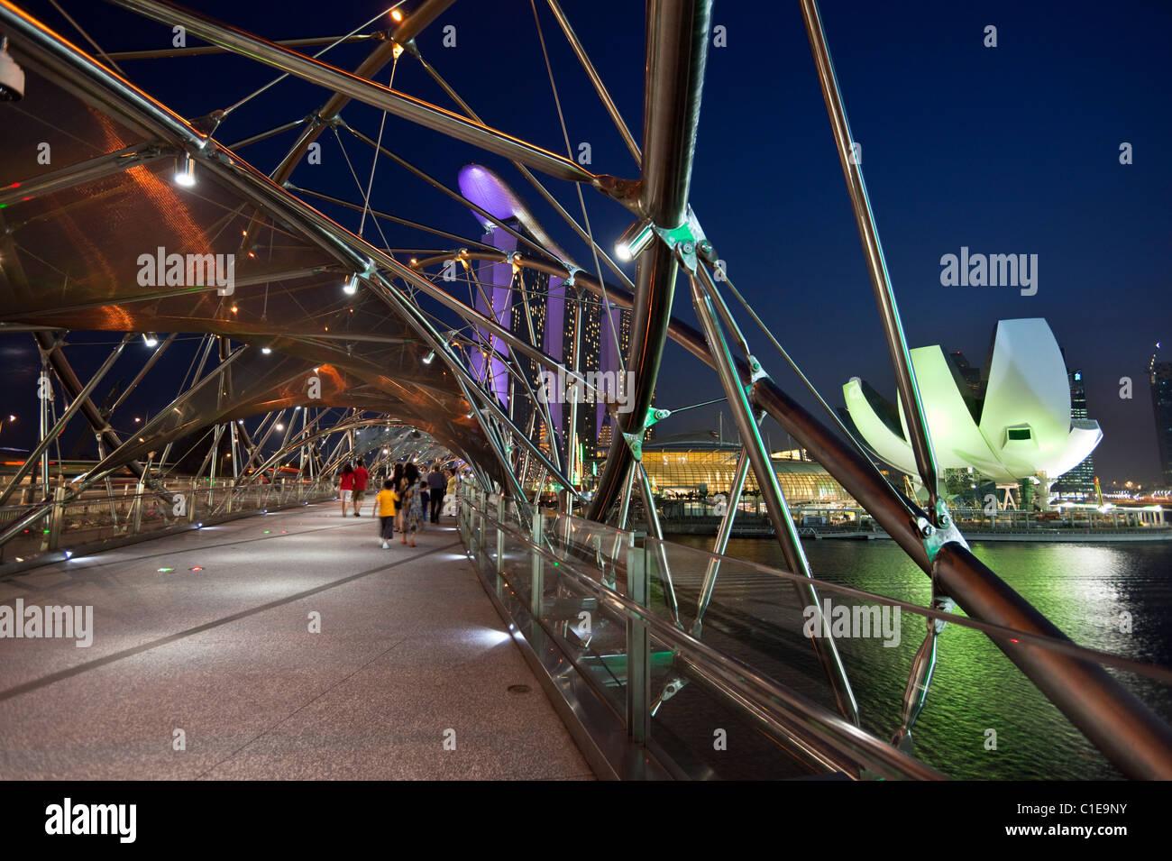 View along Helix Bridge to Marina Bay Sands Singapore.   Marina Bay, Singapore - Stock Image