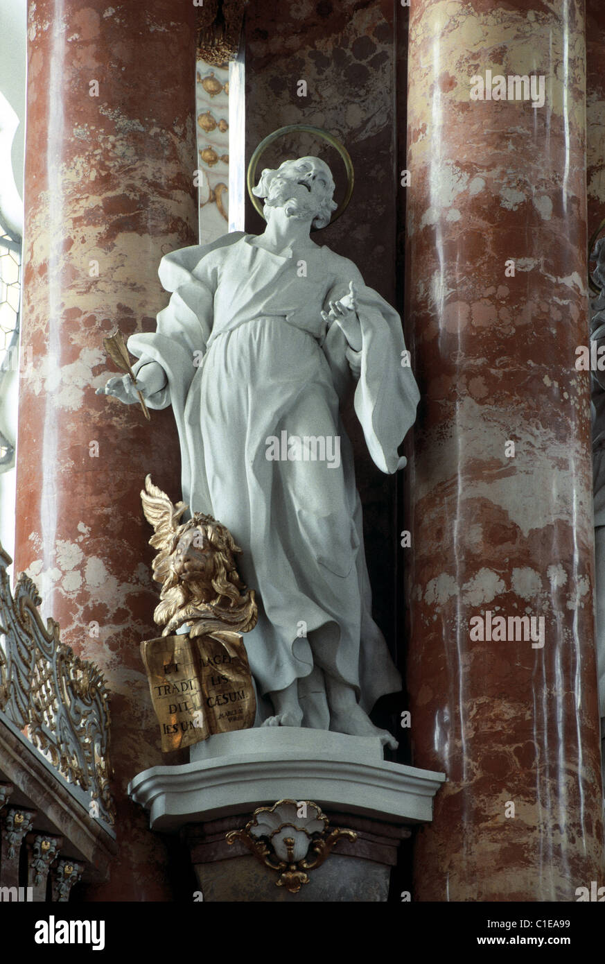 Germany, region of Bavaria, Wiese baroque church, statue of a saint in the nave - Stock Image