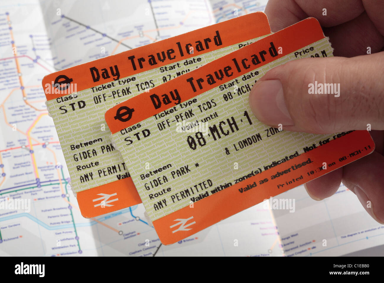 Off-Peak Day Travelcards with underground map in background - Stock Image