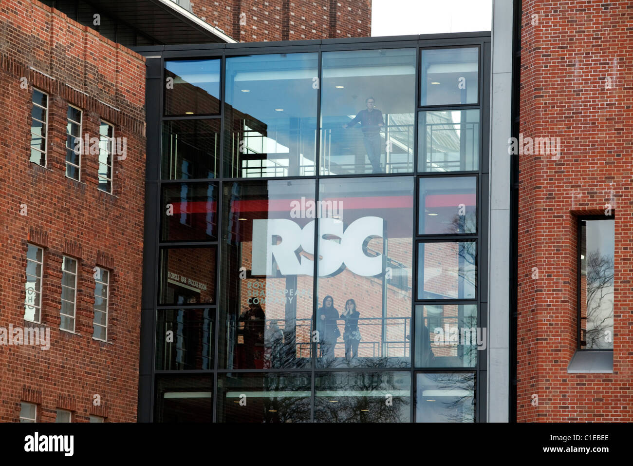 Theatre-goers looking out of the newly renovated RSC Theatre in Stratford-upon-Avon, UK - Stock Image
