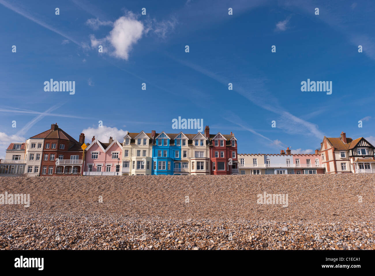 A row of colourful bay fronted houses on the seafront in Aldeburgh , Suffolk , England , Britain , Uk Stock Photo