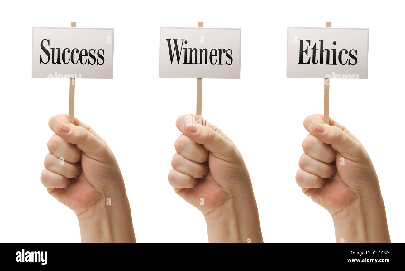 Three Signs In Male Fists Saying Success, Winners and Ethics Isolated on a White Background. - Stock Image