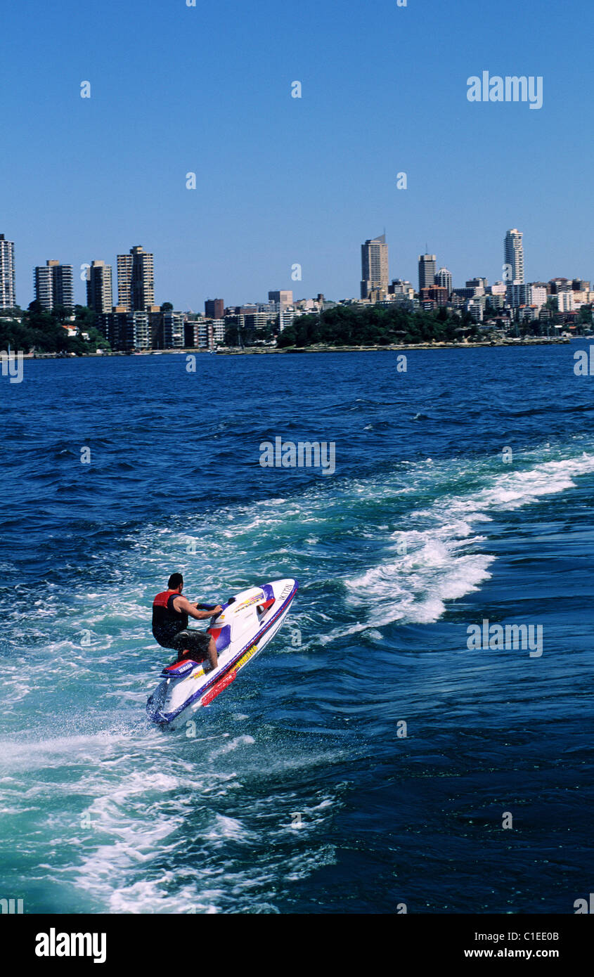 Australia, Sydney, Each week end the bay of Sydney is transformed into nautical base of leisures Jetski and city - Stock Image