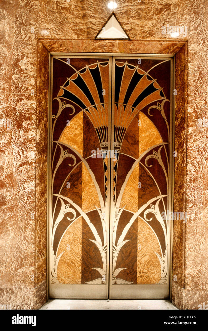 United States, New York City, Manhattan, inside the Chrysler Building, elevator door - Stock Image