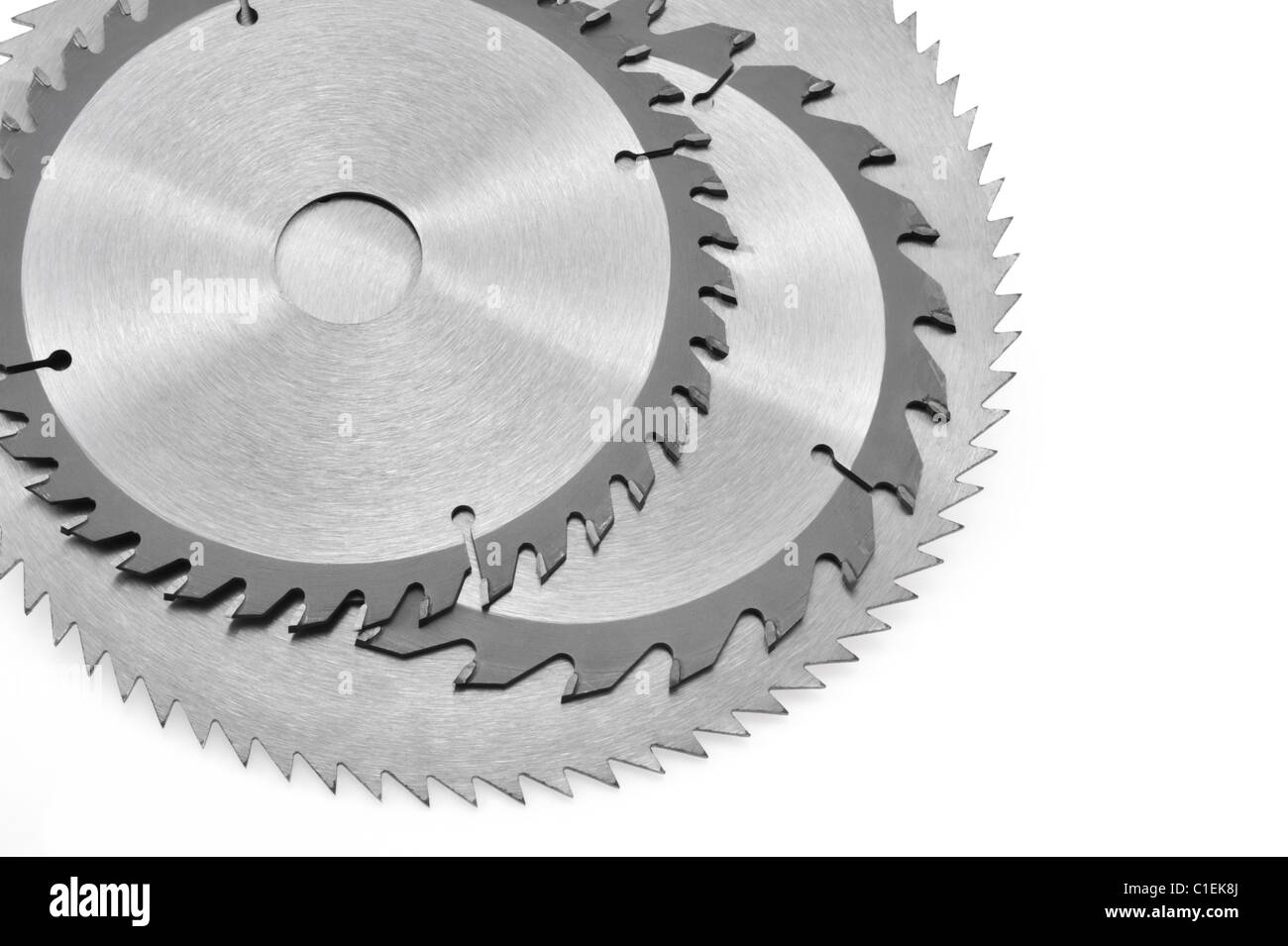 Circular saw blade for wood isolated on white - Stock Image
