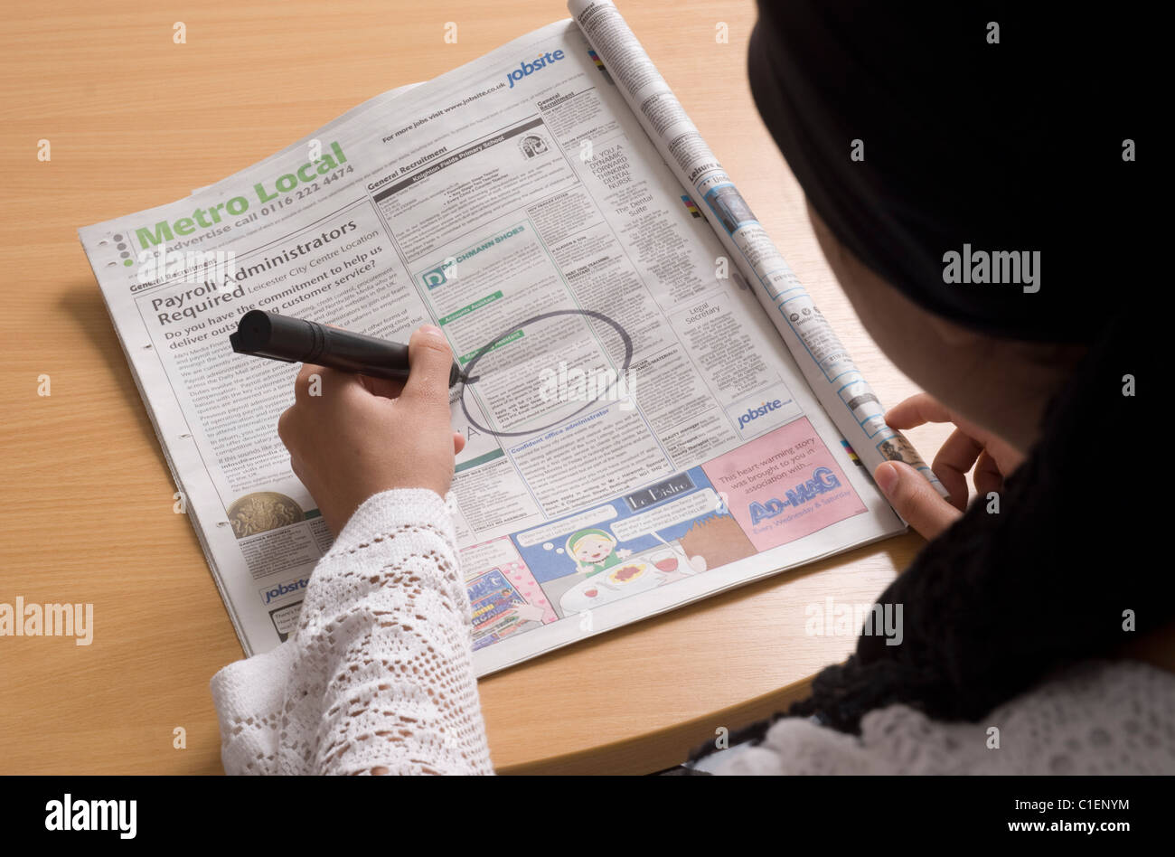 Job Hunting in a Newspaper - Stock Image