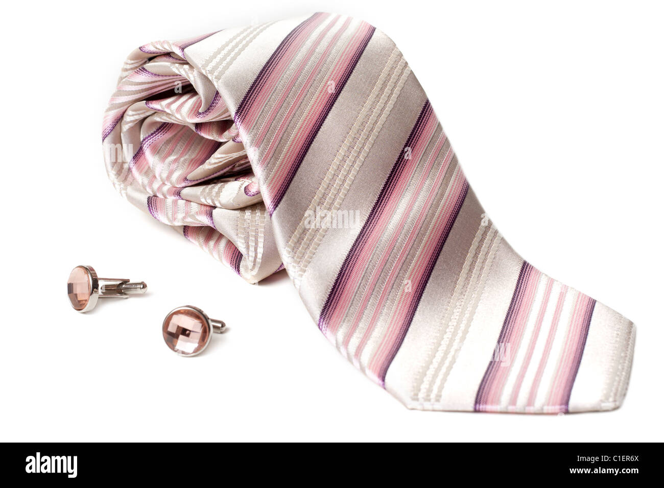 Rose striped tie and cuff links with stone insulated on white background Stock Photo