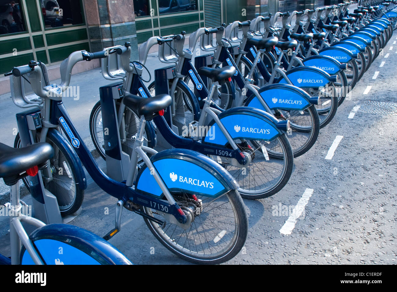 City of London , Moorgate Station , Boris or Barclays bikes for hire , transport bicycle or cycles , stands awaiting - Stock Image