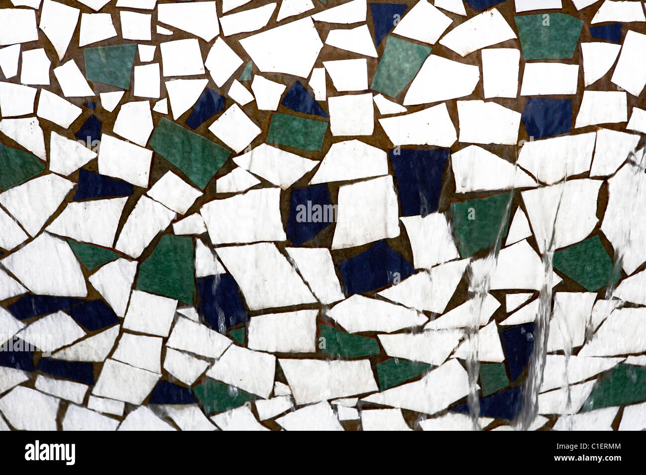 Patch of Mosaic on a fountain. - Stock Image