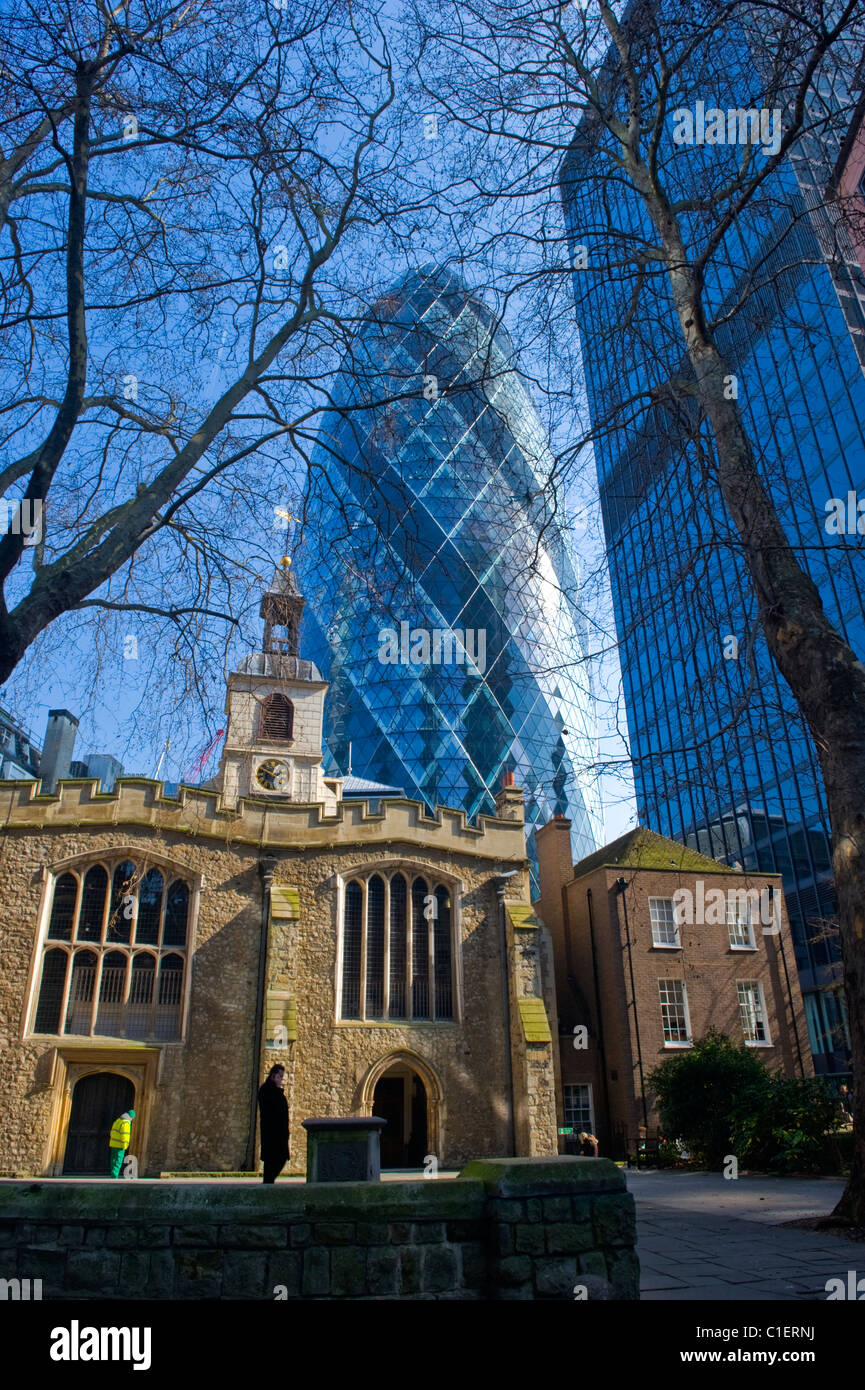 City of London , 12 c St Helen's Church , Bishopsgate with the Gherkin or Swiss Re building in background in - Stock Image