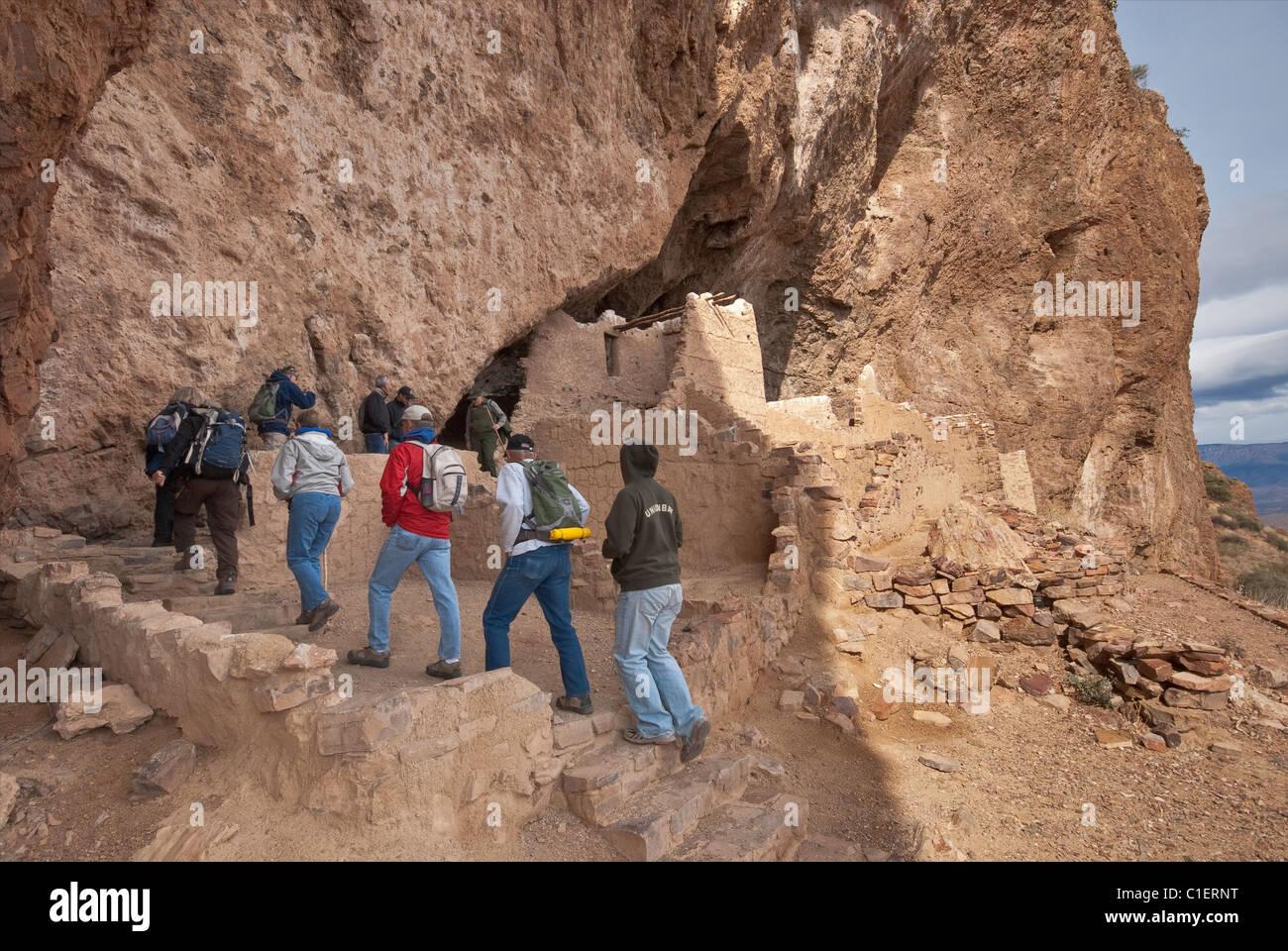 Visitors at Upper Cliff Dwelling at Tonto National Sonoran Desert, Arizona, USA - Stock Image