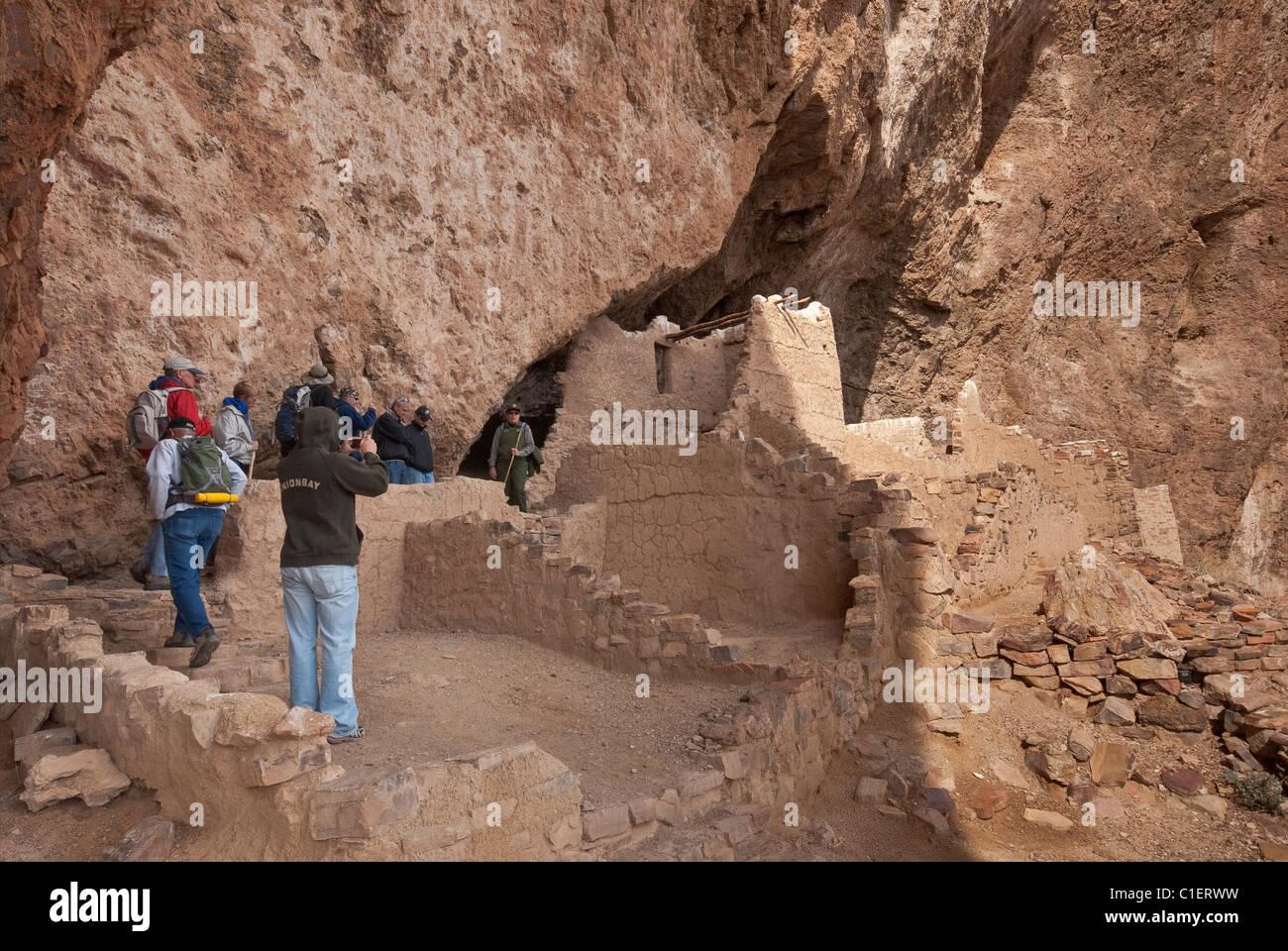 Visitors at Upper Cliff Dwelling at Tonto National Sonoran Desert, Arizona, USA Stock Photo
