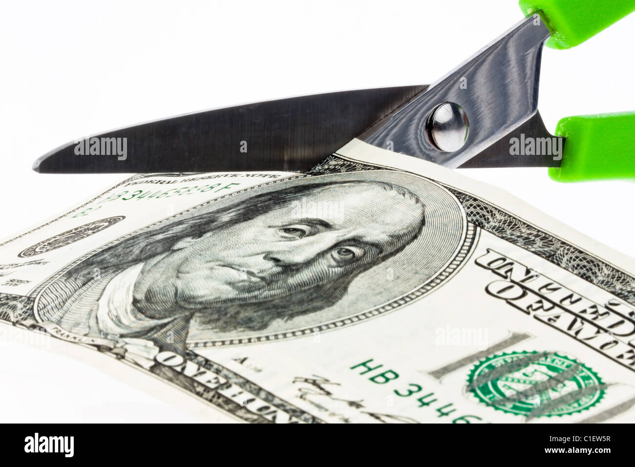 U.S. dollar bills and scissors - Stock Image