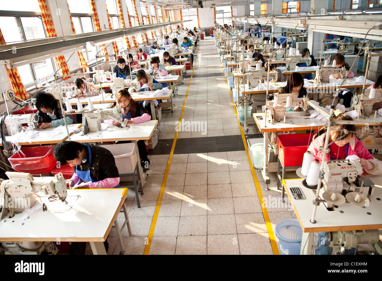 China Garment Factory worker production - Stock Image