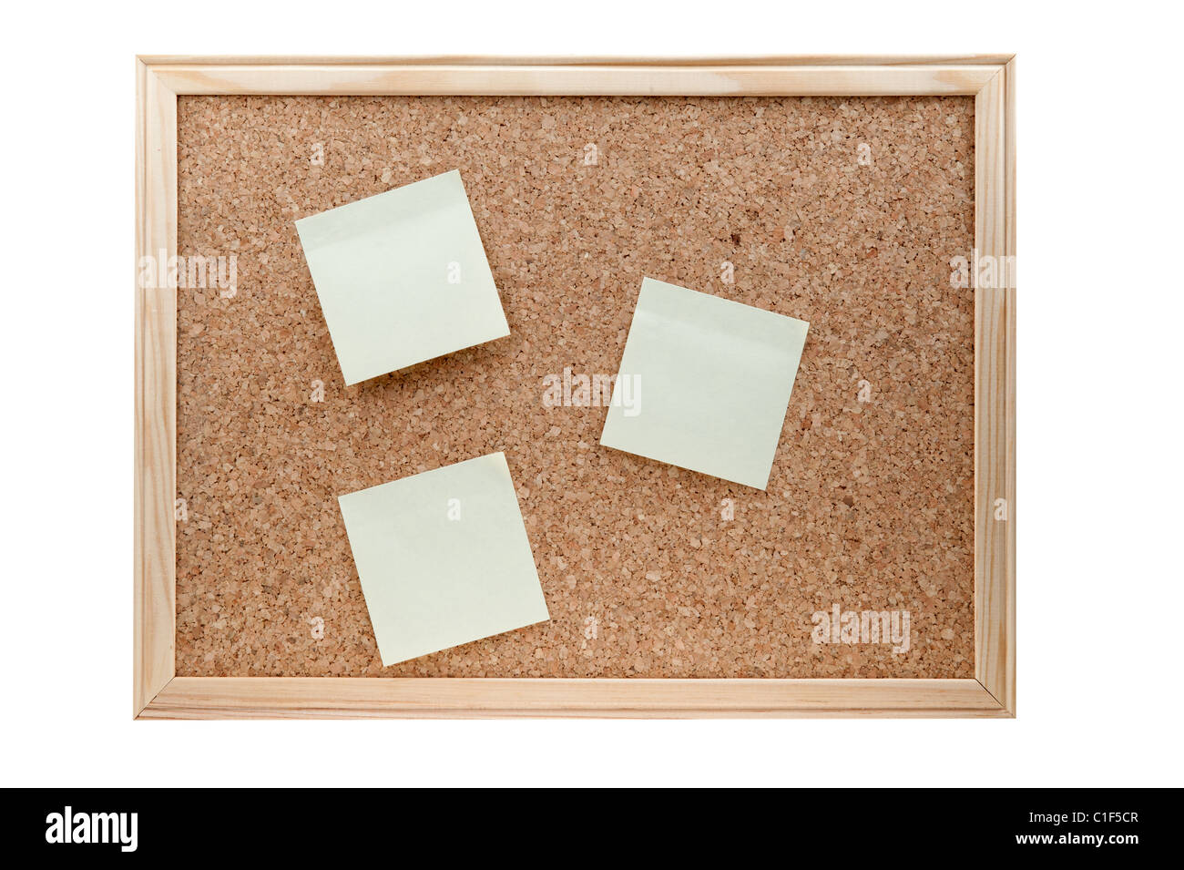 different sticky notes on a cork board isolated on a white background Stock Photo