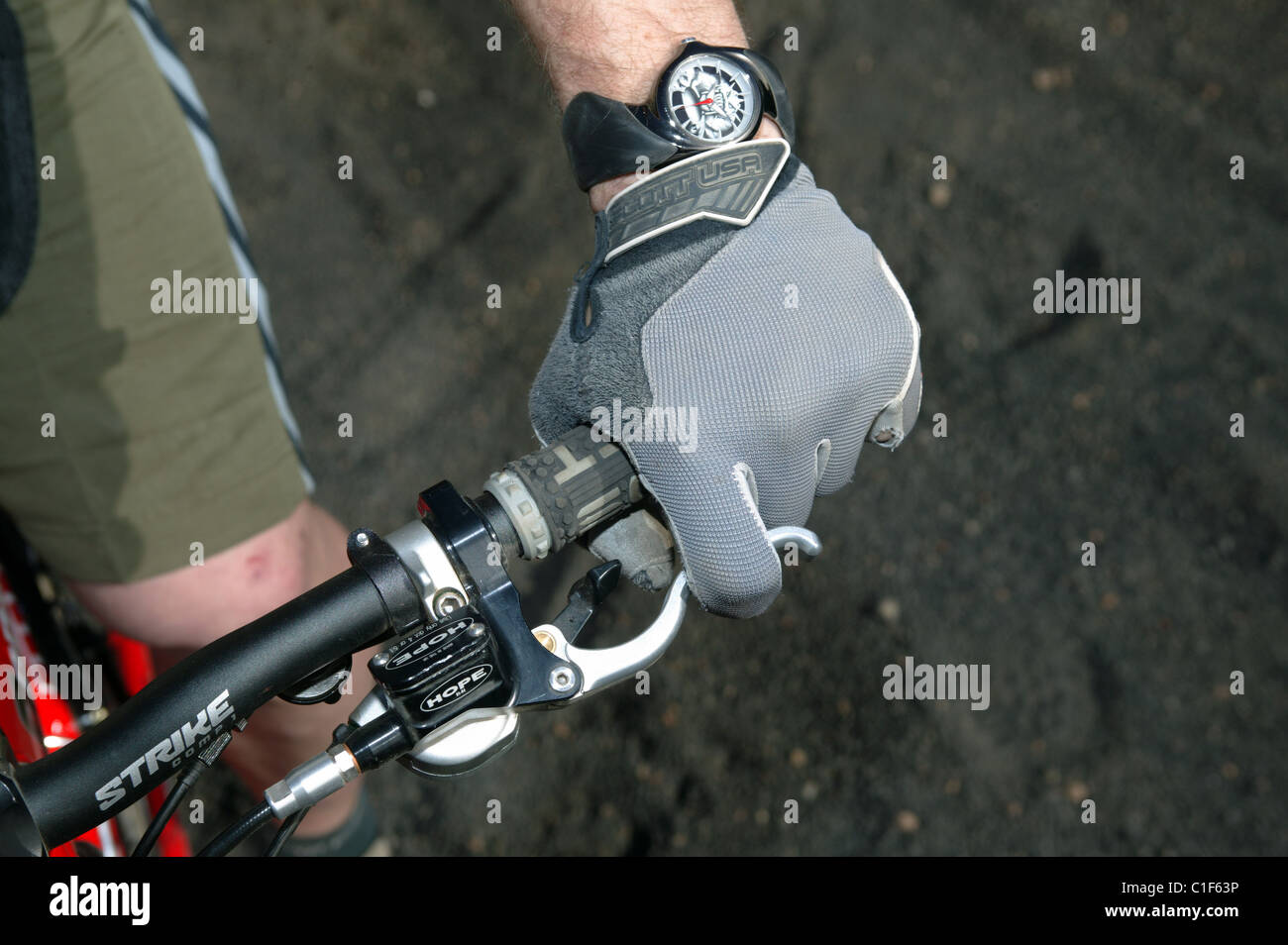 Detail of a Mountain Bikers Glove and Brake Lever, Grip and Handlebars - Stock Image