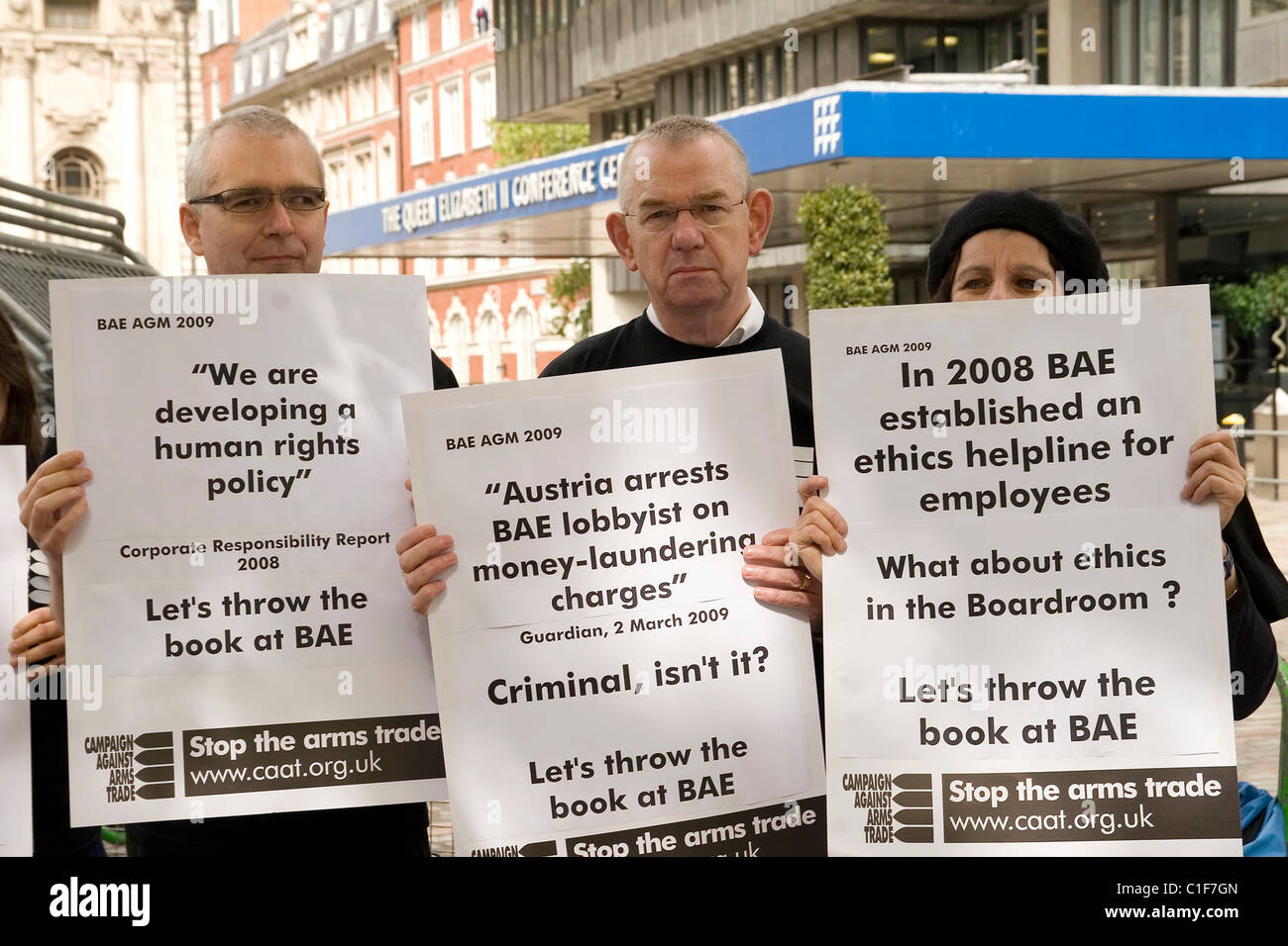 Protesters from CAAT (Campaign Against Arms Trade) demonstrate outside BAE's AGM at the Queen Elizabeth Conference Stock Photo