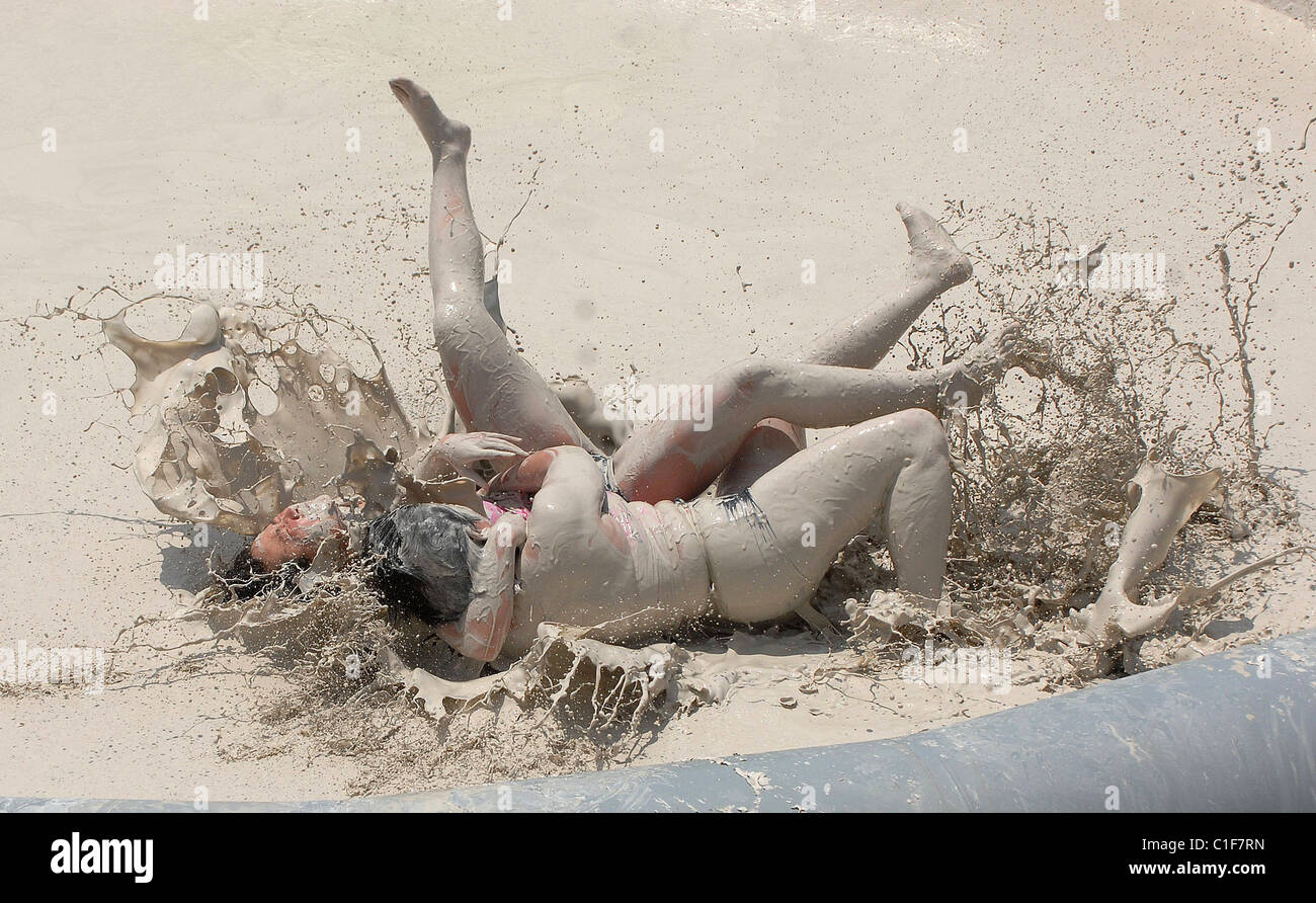 World Mud-Wrestling Championships Two filthy females grapple in a pit  during an international women's mud-wrestling event in
